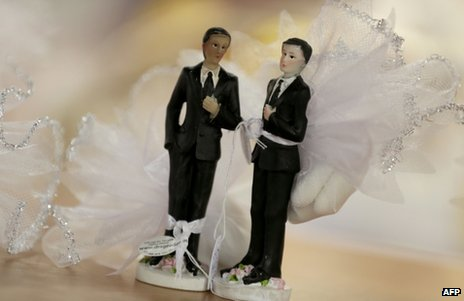 Male figurines in wedding dress on display in Paris (file image)