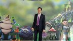 Labour leader Ed Miliband in front of Tree fu Tom image