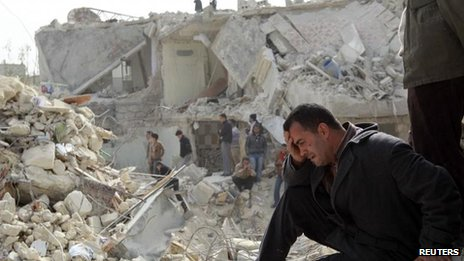 A Syrian man surveys damage caused by the conflict in Aleppo