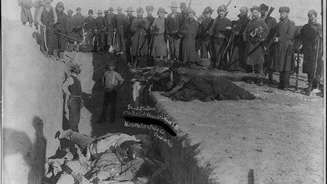 Burying the dead at a mass grave in Wounded Knee