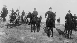 Men on horseback in an archival photo