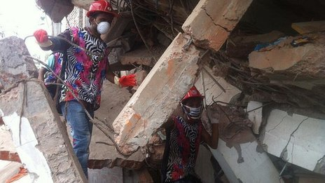 Rescuers at scene of building collapse, Dhaka. 27 April 2013