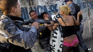 Brazilian policeman confronting protestor near Maracana stadium, 26 April 2013