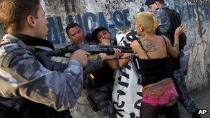 Brazilian policeman confronting protestor near Maracana stadium, 26 April 2013