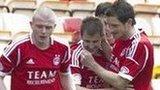 Aberdeen congratulate scorer Niall McGinn