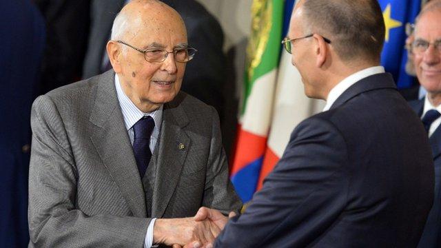 Italian prime minister-designate leftist Enrico Letta (R) shakes hand with President Giorgio Napolitano
