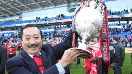 Vincent Tan with the Championship trophy