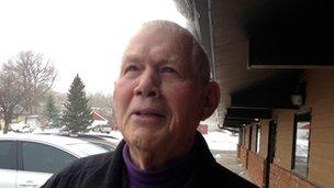 James Czywczynski stands outside a building