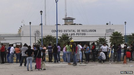 Relatives of inmates wait for information of their loved ones after inmates clashed at La Pila prison in San Luis Potosi on Saturday