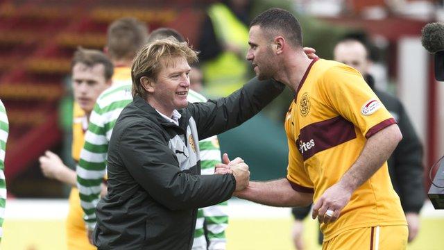 Motherwell manager Stuart McCall congratulates striker Michael Higdon