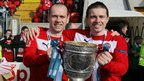 Brothers Ronan and Chris Scannell celebrate Cliftonville's title triumph on the pitch