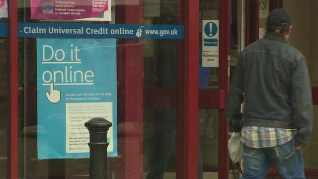 Universal Credit poster in window