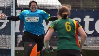 Emma Atkinson celebrates winning the shoot-out for Guernsey