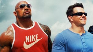 Dwayne Johnson and Mark Wahlberg in Pain and Gain