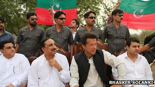 Imran Khan at a rally with his bodyguards