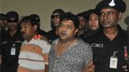 Mohammed Sohel Rana with police in Bangladesh (28 April 2013)