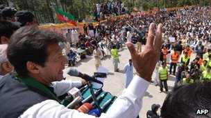 Imran Khan (L) addresses supporters during a rally in Meree, Pakistan