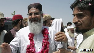 Maulana Ludhianvi (L) greets supporters at an election rally in Jhang, Punjab