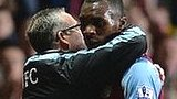 Aston Villa manager Paul Lambert embraces Christian Benteke