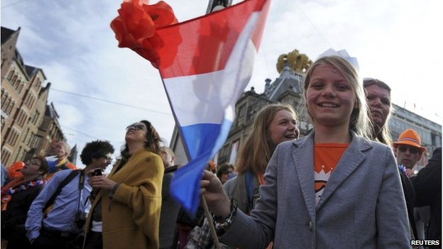 Woman waving national flag in Amsterdam (30 April 2013)