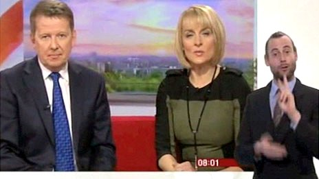 Screengrab of Rob Skinner signing to BBC Breakfast