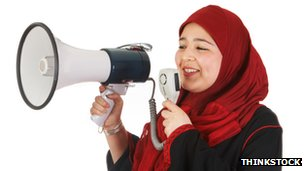 A Muslim woman using a megaphone