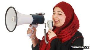 A Muslim woman using a megaphone