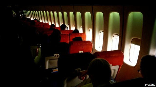 Passengers in seats on airplane