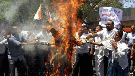 Opposition Congress Party activists protest in Bhopal, India, on 30 April 2013