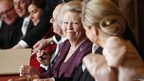 Queen Beatrix smiles at her daughter-in-law at the abdication ceremony in Amsterdam on 30 April 2013