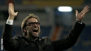 Borussia Dortmund coach Jurgen Klopp celebrates at the final whistle