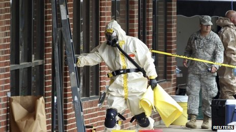 A hazmat official enters a taekwondo studio previously operated by James Everett Dutschke in Tupelo, Mississippi 24 April 2013