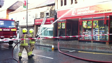 Firefighters at the scene six hours after the blaze broke out