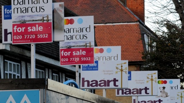 Estate agents boards lining a street in Lambeth
