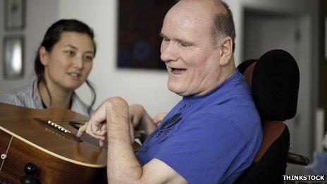 Man in wheelchair playing guitar