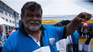 Marimuthu Seeniueasan, a Barisan Nasional supporter, with his new apartment keys