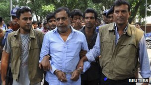 Rana Plaza owner's father, Abdul Khalek, is escorted by police