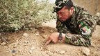 Sgt Abdullah Rezai, of the Afghan National Army, is trained in bomb disposal