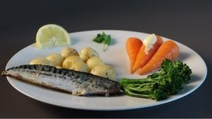 Healthy meal of mackerel, potatoes, steamed carrots and broccoli, tsp of spread