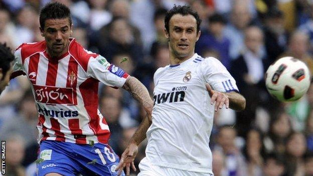 Nacho Novo (left) in action for Sporting Gijon against Real Madrid
