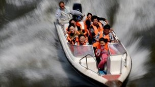 Chinese having fun in speedboat