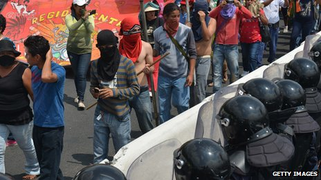 Teachers and students protest in front of anti-riot policemen in Acapulco
