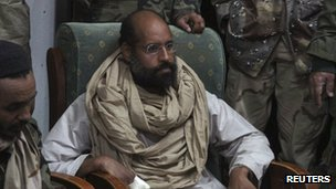 Saif al-Islam is seen after his capture, in the custody of revolutionary fighters in Obari, Libya November 19,