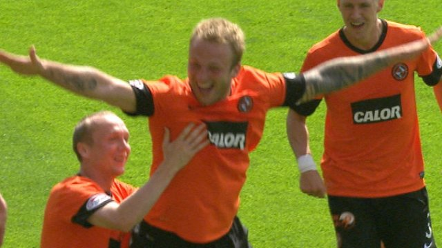 Dundee United striker Johnny Russell (centre)