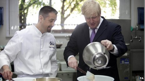 Mayor of London Boris Johnson makes a Gu chocolate souffle with head chef