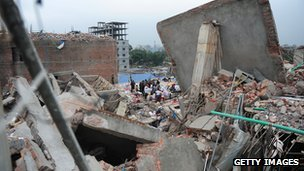 Bangladeshi volunteers and rescue workers look for survivors in an eight-storey building that collapsed in Savar.