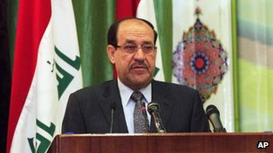 Nouri al-Maliki addresses a convergence of religions conference in Baghdad on 27 April