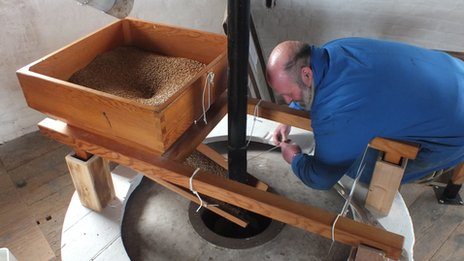 Mill worker tests the new sails to produce flour
