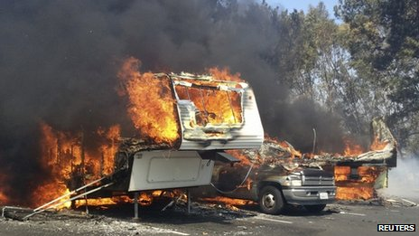 Recreational vehicles burn at the Springs Fire in the Camarillo Springs area of Ventura County, California on 2 May 2013