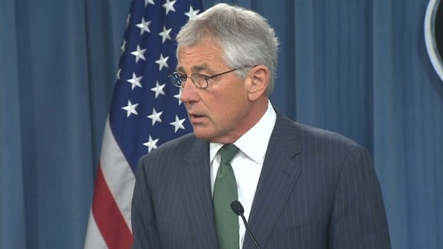 Chuck Hagel at a press conference with British General Hammond